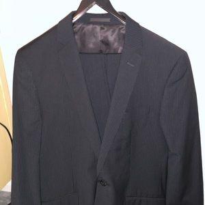 Black pinstripe suit.